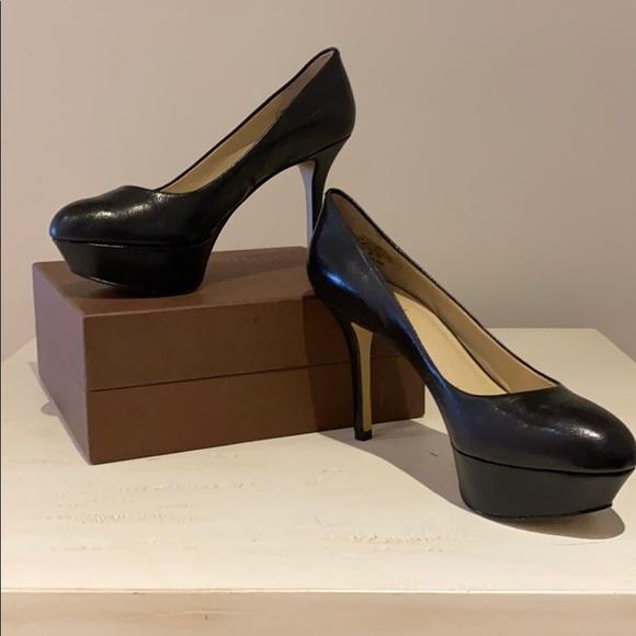 Nine W., platform, pump, 4 inch black. Size 8 1/2